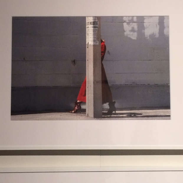 Woman in red pillar hidden Guy Bourdin