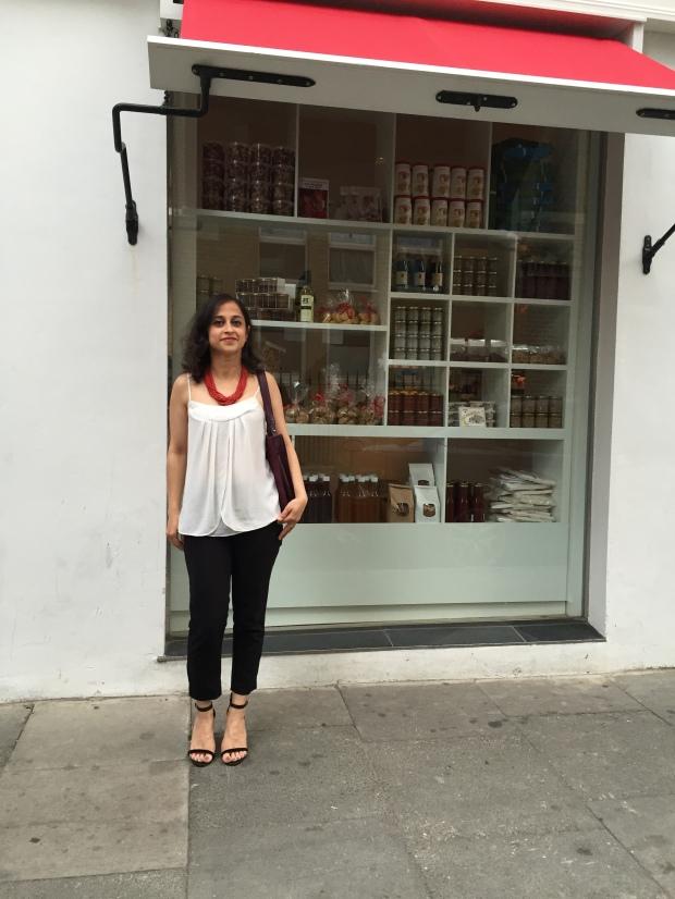 ILEX London white camisole black pants red statements necklace