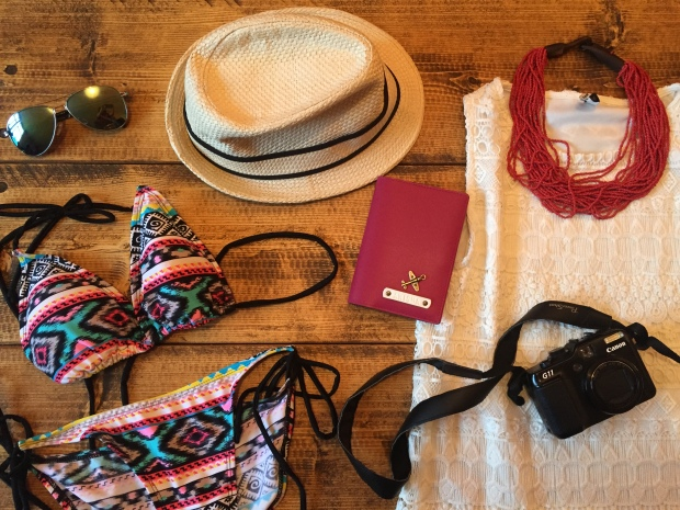 Flatlay beach ear bikinis hats vacation holiday