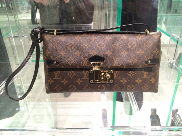 Louis Vuitton logo clutch
