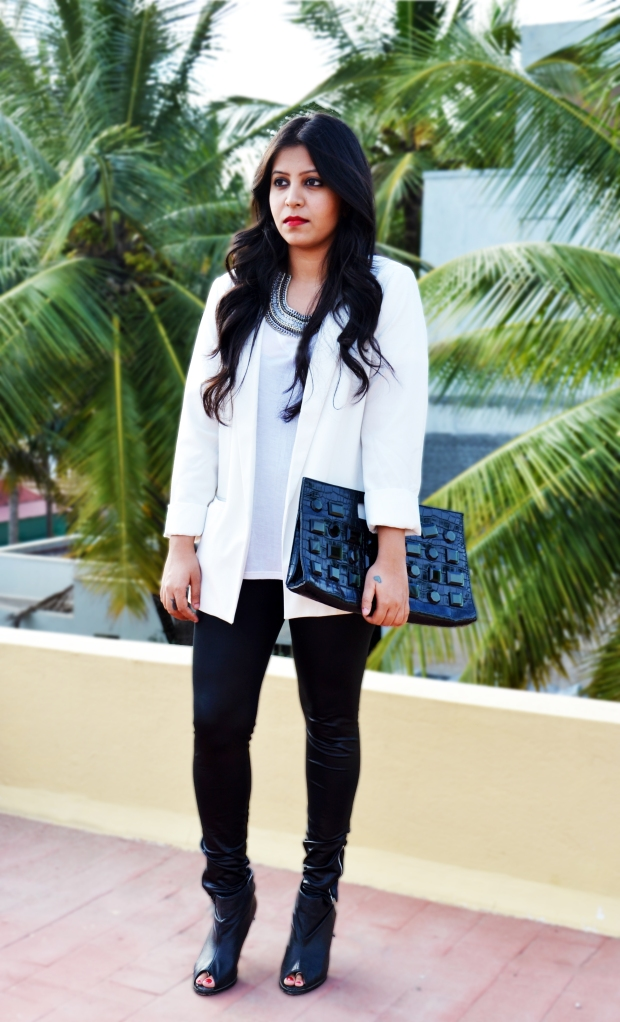 white jacket and faux leather leggings